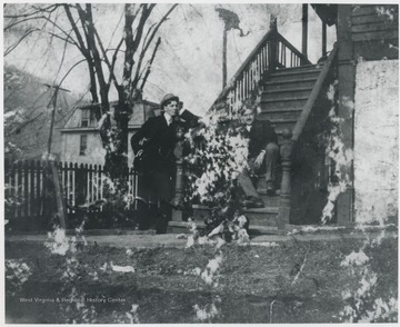 Murrell pictured leaning on the porch steps of his home located on the corner of Summers Street and 5th Avenue. Man sitting on the steps is unidentified.
