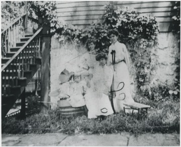 Mrs. Robert Murrell is pictured seated. The other women are unidentified.