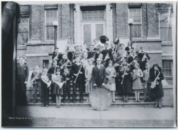 Photo taken of an old class photo at Hinton High School. The group appears to be the school's marching band and conductor. Subjects unidentified.