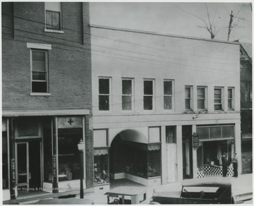 The building, located on Temple Street, is home to many stores including Dr. Abott's Dentisttry (pictured on the right) and a drug store (pictured on the left). Alderson-Shumate Bootery pictured in the center.