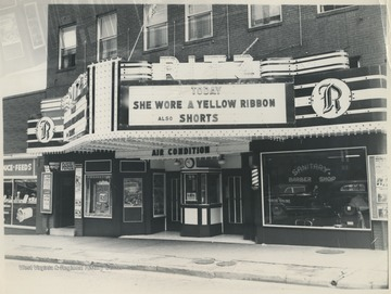 "The building, located on Ballengee Street, is advertising ""She Wore a Yellow Ribbon"" playing that day."