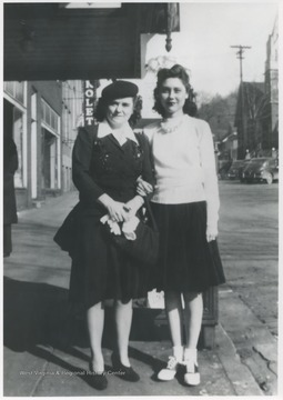 Lona Richmond, left, and Betty Jane Arrington Angell, right, pose in front of the theatre on Ballengee Street.