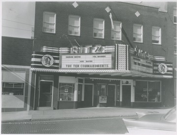Street view of the building located on Ballengee Street. The theatre is advertising The Ten Commandments.