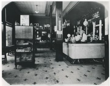 Mr. Welfrey, left, and Leo Poteet, right, stand behind the counter of the store located inside the McCreery Hotel.