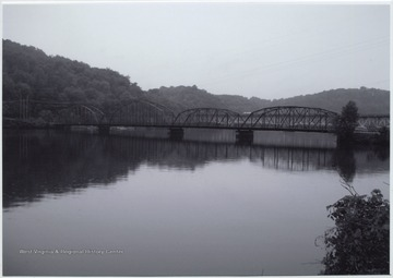 Photo showing the bridge that was built in 1922 by the Independent Bridge Company of Pittsburgh. It spans across Cheat Lake along County Route 857.