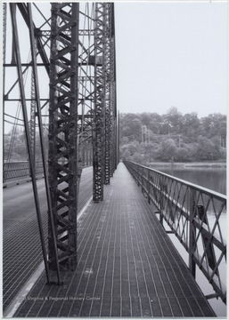 Photo showing the poor condition of the bridge over Cheat Lake. The bridge was built in 1922 by the Independent Bridge Company of Pittsburgh. It spans across the lake along County Route 857.