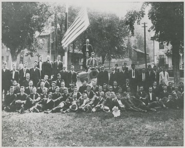 A group of unidentified men pose beside the newly acquired Civil War cannon. This ancient piece of artillery is claimed to weight 16,500 pounds and was used by the southern states. The cannon was transported from the state of Florida, specifically. Former Congressman Littlepage donated the item to the city.
