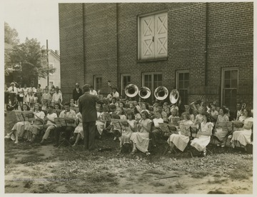 A band comprised of young musicians play outside Summers Memorial Building.