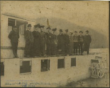 The boat traveled on New River from Hinton to Bull Falls.Pictured from left to right, an unidentified boy, , Ernest Bond, Harriett Campbell Hall, Mrs. W. H. Gwinn, W. H. Gwinn, Mrs. S. W. Poore, S. W. Poore, Oliver Graham, Mattie Graham Humphrey, Charlie Poore, Jim Gwinn, and F. H. Jennings.