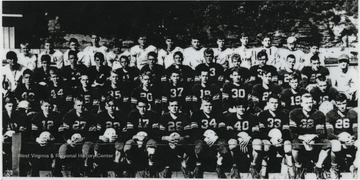 "Portrait of the football team that had a winnin season, losing only their last game against Beckley High School.1st row, left to right: Billy Carl Meadows; Jack Westfall; Robert Morriss; K. D. Foster; Phil Dupriest; Kyle Gwinn; Jack Johnson; Jimmy Hartley; Bobby Jack Crush; Howard ""Curley"" williams; ""Buck"" Seldomridge2nd row, left to right: ""Snooks"" Dobbins; Paul Phipps; Charley Patrick; Jimmy Ellison; Ernie Moore; Dennie Surber; Dutch Holbert; Bill Jenkenson; Tootie Woods; Tink Ritter; Richard Patrick3rd row, left to right: Coach Stan Huffman; Pete Johnson; Bobby Hoffer; Dick Gunnoe; Clifford Ratliff; Pat Shires; Garland Tyree; Carl Houchins; Buzzy Hellems; Tom Halloran; Hammy Brown; Crow Hellems; Coach Harold Beasley4th row, left to right: Ronnie Keaton; Dickie Wiseman; Dave Hess; Bobbie Meadows Pollock; unidentified; Cyrus; Mose Lilly; Ray Surbaugh; Nick Cantrell; Danny Keaton; Chubby Willey; Yancey; and Dough Richmond."