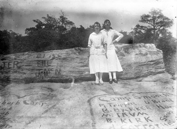 "Location is probably at the main overlook of Coopers Rock State Forest.  Many names, initials, and phrases are written on the rock including ""Camp Smooch""."