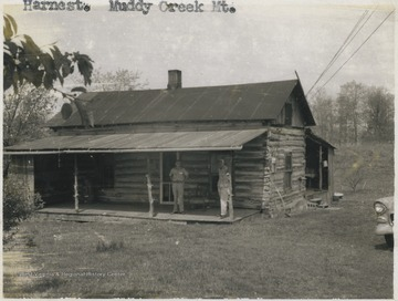 Two unidentified men are pictured under the cabin's awning.