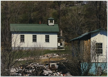 Looking at the church building located on Snowflake Quarry Road in Snowflake Village. The church is on Louis Longanacre's property. Built ca. 1900, the members who attended this church worked in the quarry.