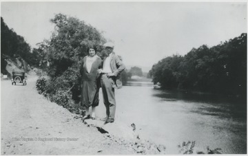 The two unidentified persons pose beside the river on what is now Route 3 below Alderson, W. Va.