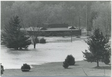 Flood waters submerge the country club grounds and surround the club house.