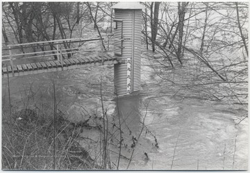 "Gauge at the Willowood Bridge is pictured with water at the ""23"" mark, probably measuring in feet."