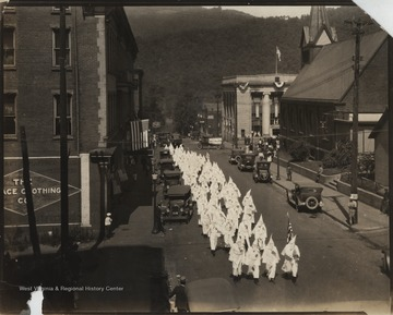 KKK members strut down 2nd Avenue between Ballengee and Temple Streets in their hoods and robes. The white supremacy organization spread to Hinton but the group's appearance there was not associated with violence as it was in many other parts of the nation.Since then, the Klan's presence has passed from the local scene.