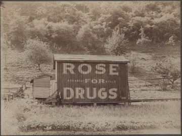 Rose with the advertisement on the south-side of Hinton near mouth of Madam's Creek.