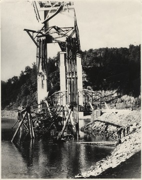 Five workmen killed and four injured when the 300-ton span buckled and folded downward into the mouth of Bluestone River. A week after the collapse the men began dismantling the twisted span, using a never before used technique by burning the steel beams with chemicals.