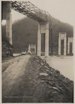 Ground view of the disaster.Five workmen killed and four injured when the 300-ton span buckled and folded downward into the mouth of Bluestone River.A week after the collapse the men began dismantling the twisted span, using a never before used technique by burning the steel beams with chemicals.