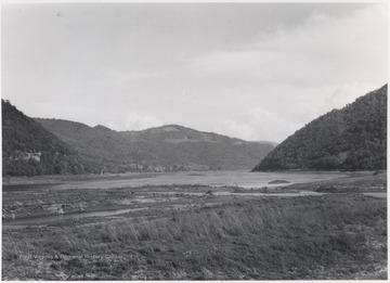 Looking at the beginning of a reservoir created by the Bluestone Dam. To the right of the area pictured is the mouth of the Bluestone River.