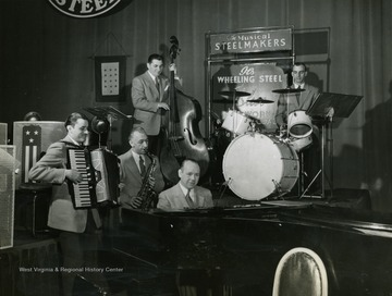 "Caption on back of photograph reads: ""Here's the same quintet on Sunday, running over a number before air time. Lew Davies is the conductor of the program's 23 piece orchestra of mill, plant, and office workers."""