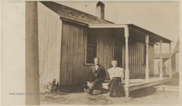Lark and Nannie pictured sitting on the porch outside their home, where Prince and Eva Neely first set up married life. The house is located near the Larkin-Meadors store.