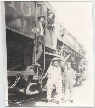 Donald Brightwell pictured on the steps of the train. Mr. McClean is in the window. Standing on the ground beside the train is A. F. Pete Sentz and Fred Worles.
