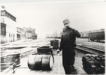 Roy Shrewsbury is pictured by the railroad tracks. An old storeroom is pictured in the background.