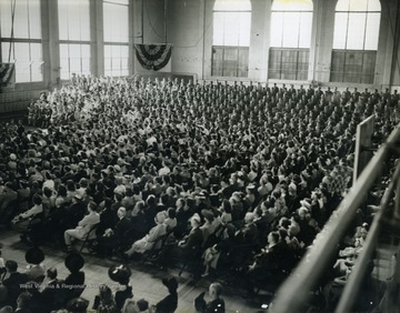 "Picture taken during Wheeling Musical Steelmakers performance at WVU Field House, which was part of their ""Buy a Bomber"" series, where communities were challenged to buy enough Defense Bonds to purchase a bomber. The money raised in this circumstance exceeded all expectations and was the largest such fundraiser in Monongalia County, West Virginia."