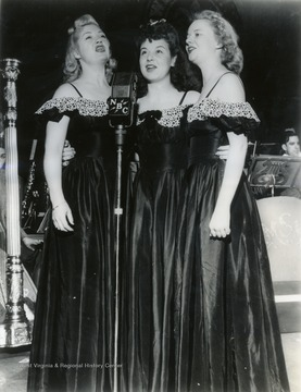 "Caption on back of photograph reads: ""When the Musical Steelmakers are heard each Sunday, starting October 5, over at Station ___ at ___ o'clock these three pretty singers, the Steel Sisters, will help add to the gaiety and tunefulness of the programs. They are, from the left, Lois Mae Nolte, Harriet Drake, and Lucille Bell. Like other members Musical Steelmakers troupe they are either employees in the steel industry or members of employee families."" The first all employee broadcast. The Steel Sisters eventually gained so much recognition that they went on tour with Horace Heidt and his orchestra."