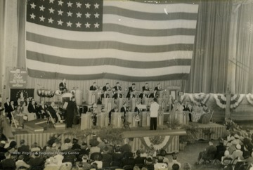 "Picture taken of performance inside of WVU Field House, which was part of the ""It's Wheeling Steel"" radio program's ""Buy a Bomber"" series, where communities were challenged to buy enough Defense Bonds to purchase a bomber. The money raised in this circumstance exceeded all expectations and was the largest such fundraiser in Monongalia County, West Virginia."