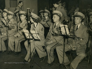 "Caption accompanying photograph reads: ""The Yorkville Works Brass Band has made several pleasing headliner appearances of the family broadcast. All in their snappy uniforms, thus adding color for the visible audience of ""It's Wheeling Steel""."""