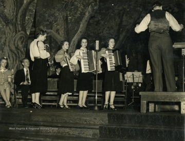 "Caption accompanying photograph reads: ""Something unique for any broadcast is an accordion quartet of young ladies. The first is Nancy Row, granddaughter of a founder of Wheeling Corrugating, next is a young lady who, together with her brother is employed at Yorkville. Third's father was employed by the corporation. Fourth is a teacher."""