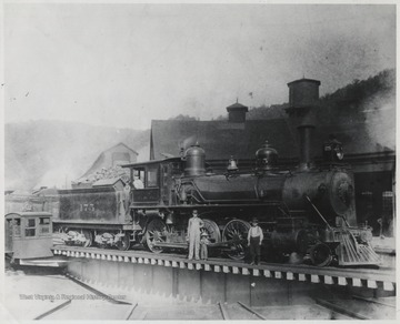 Stoddard family pictured beside the turntable, which was 900 feet in circumference.