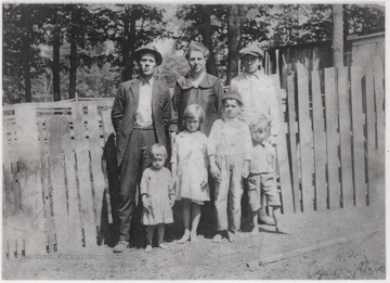 Front row, from left to right, is Piney M. Lilly, Grace B. Lilly, Ernest L. Lilly, and Edward P. Lilly.Pictured in the back row is Thomas W. Lilly, Mary E. Lilly, and her son, Blake Farley.