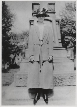 Johnson stands in front of the monument located right outside the courthouse.