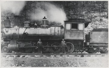 Two unidentified railroad employees stand beside Engine No. 201 on the C. & O. Railway.