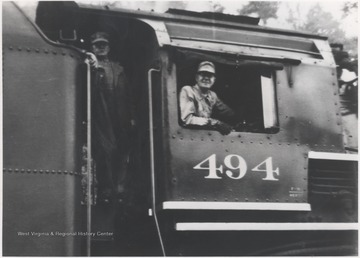 Wm. Arrington pictured on the engine.
