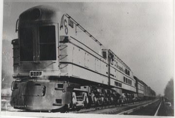 Photo of the first coal-burning, steam, turbine, electric engine--the largest single unit locomotive in the world. As long as 154 feet and 9 3/4 inches, including the water tender. The top speed was 100 miles per hour. The engine weight 411.5 tons.