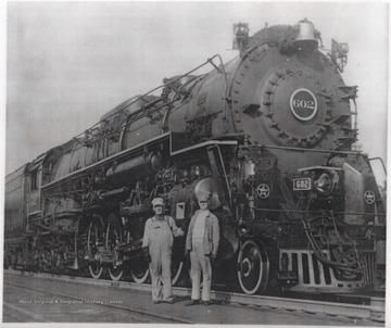 Engineer L. J. Brown, left, and fireman Lloyd Bryant, right, are pictured next to the locomotive.