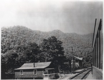 C. & O. Railway tracks pictured beside the small buildings.
