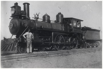Legendary engineer, Richardson, pictured in white coveralls, poses next to new American engine No. 70 after a run from Hinton.