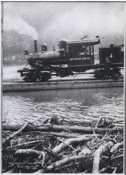 An unidentified man stands beside the thirty-five ton steam engine as it's ferried across the river.