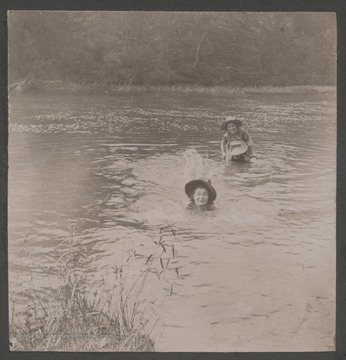 """Daisy"" Miller Gooch pictured in the fore ground splashing. The girls are relatives of James H. Miller."