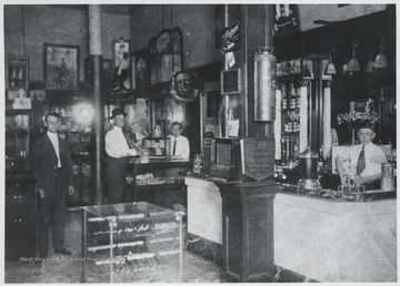 John Rose, Charlie Rose (fountain boy) and Shan Rose (behind counter) pictured inside their store.
