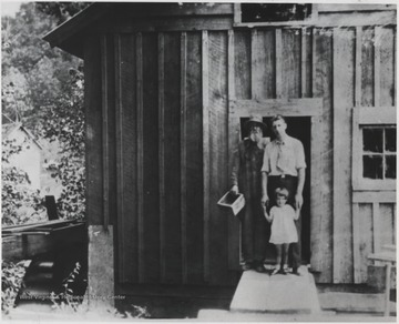 From left to right is Thomas Moody Cooper, owner of Cooper's Mill from 1895-1945; Roy Ellison, husband of Audrey Wills; Elenite, Roy and Audrey Ellison's daughter who later became Mrs. Milton B. Wise.