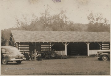 A group of women are pictured sitting outside of the building.