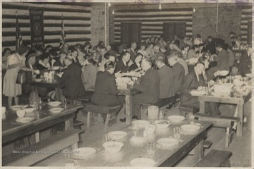 Club members gathered in the dining hall for a club meeting.