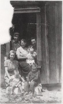 Mrs. Maude Wiseman Adkins in center with Depsey Adkins to the right and Gladys Richmond Adkins to the left. Dalena Boone is left of Badie Bracken Adkins, who is the girl in the front, and left of her is Joyce Delano. Nile Boone is the boy sitting in the front.